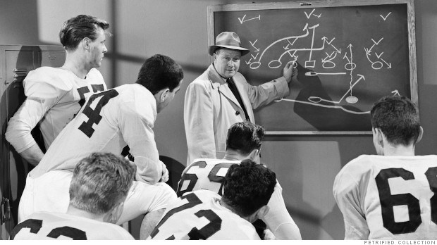 COACH SHOWS FOOTBALL PLAYERS DIAGRAMS IN 1950
